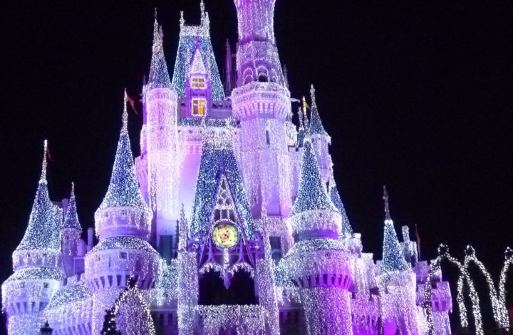 Cinderella's Castle lit up at night.